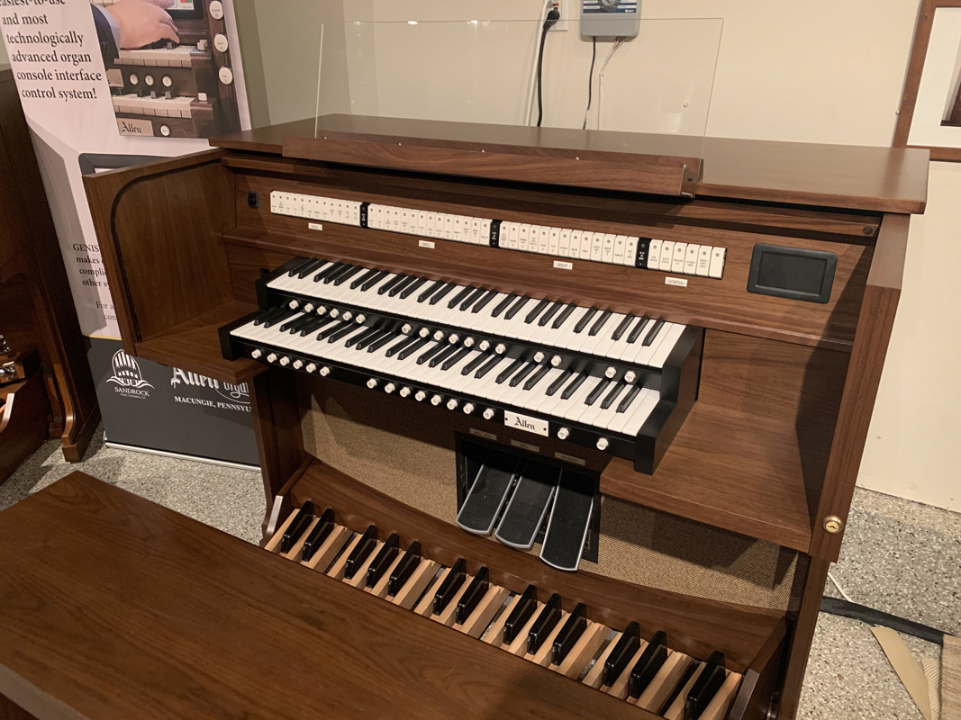 Allen Organ G210 – This organ includes 34 Stops with GENISYS™ Voices, Efficient LED tab stop controls, GENISYS™ Display, Two-Manuals, 32-note AGO pedalboard, Illuminated clear acrylic lighted music rack and pedal light, GENISYS™ Remote, Hymn-Player™, Performance Player™, 10 General and 6 Divisional pistons, Medium-oak console finish with locking rolltop, Lift-lid bench with storage area, Self-contained and external audio.  Contact Sandrock Music for more information.