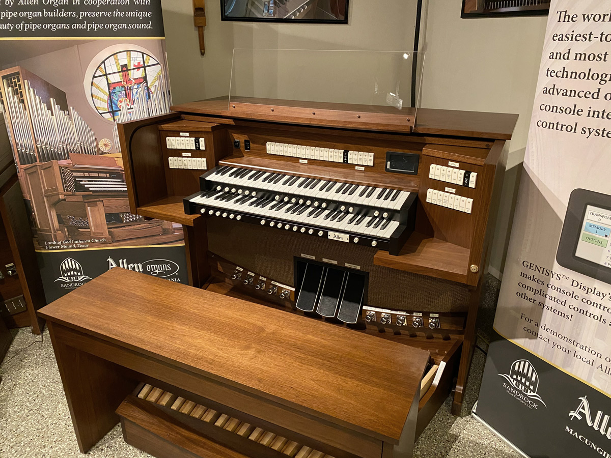 Allen Organ G220i – This organ includes 39 Stops with GENISYS™ Voices, Efficient LED tab stop controls, GENISYS™ Display, Two-Manuals, 32-note AGO pedalboard, Clear acrylic music rack, GENISYS™ Remote, Hymn-Player™, Performance Player™, 10 General and 6 Divisional pistons, Dark-walnut console finish with locking rolltop, Lift-lid bench with storage area, Self-contained and external audio.  Contact Sandrock Music for more information.