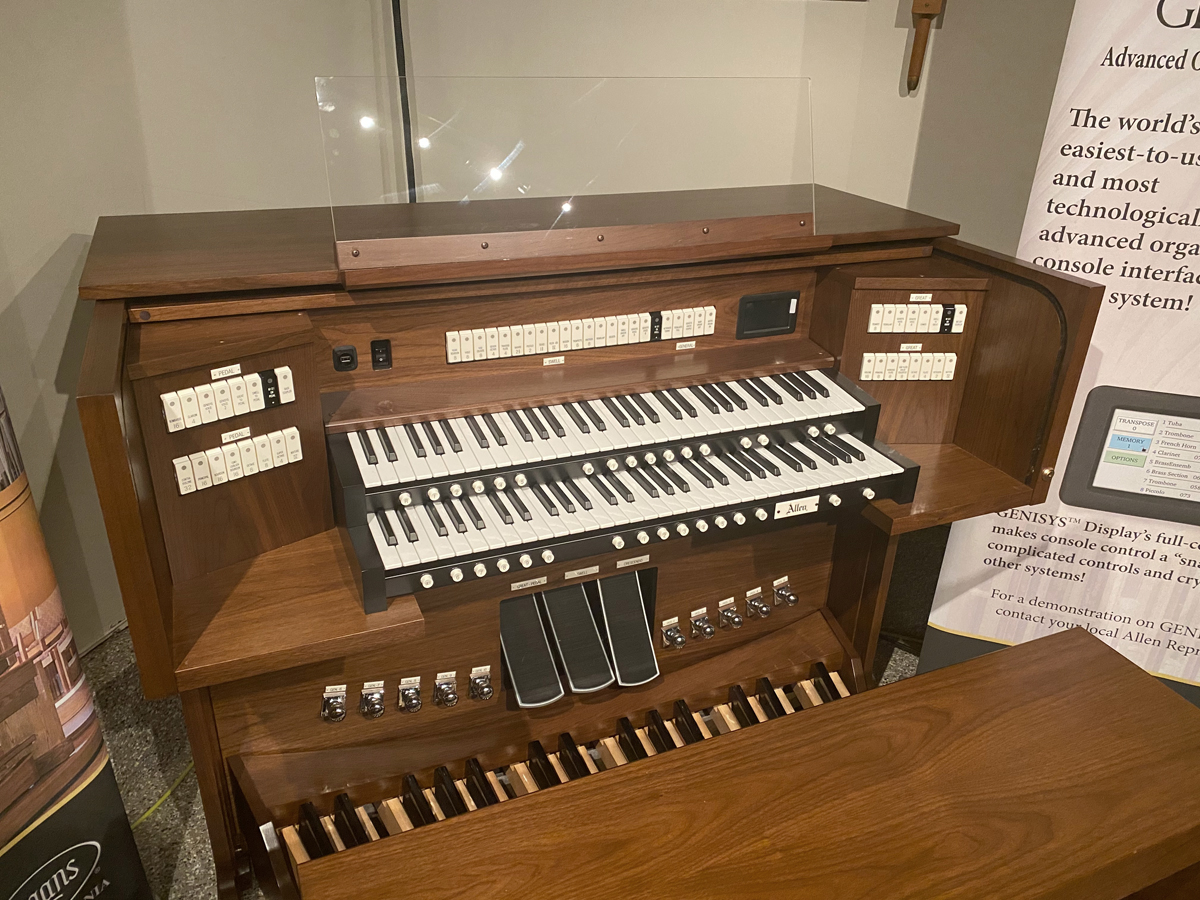 Allen Organ G220e – This organ includes 39 stops with GENISYS™ Voices, Efficient LED tab stop controls, GENISYS™ Display, Two-Manuals, 32-note AGO Pedalboard, Clear acrylic music rack, GENISYS™ Remote, Hymn-Player™, Performance Player™, 10 General and 6 Divisional pistons, Dark-walnut console finish with locking rolltop, Lift-lid bench with storage area, External audio.  Contact Sandrock Music for more information and pricing.